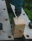 Drilling blocks of wood for a diy bee house